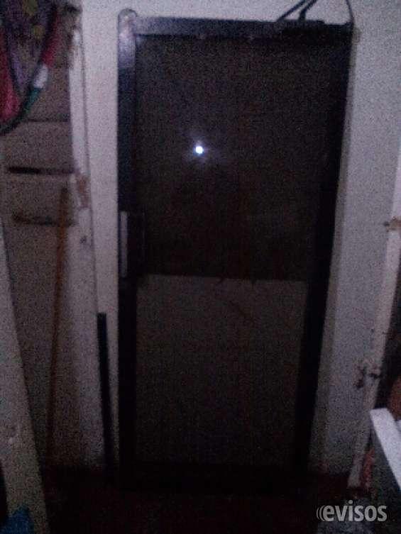 Vendo una puerta de cristal de local commercial negra